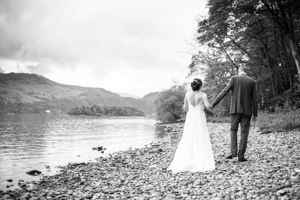 Walking along the shore, Lingholm wedding, Lake District