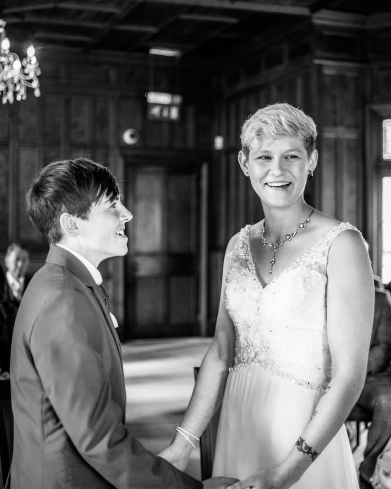 Laughing in ceremony, Carlisle Register office, Lake District wedding photography