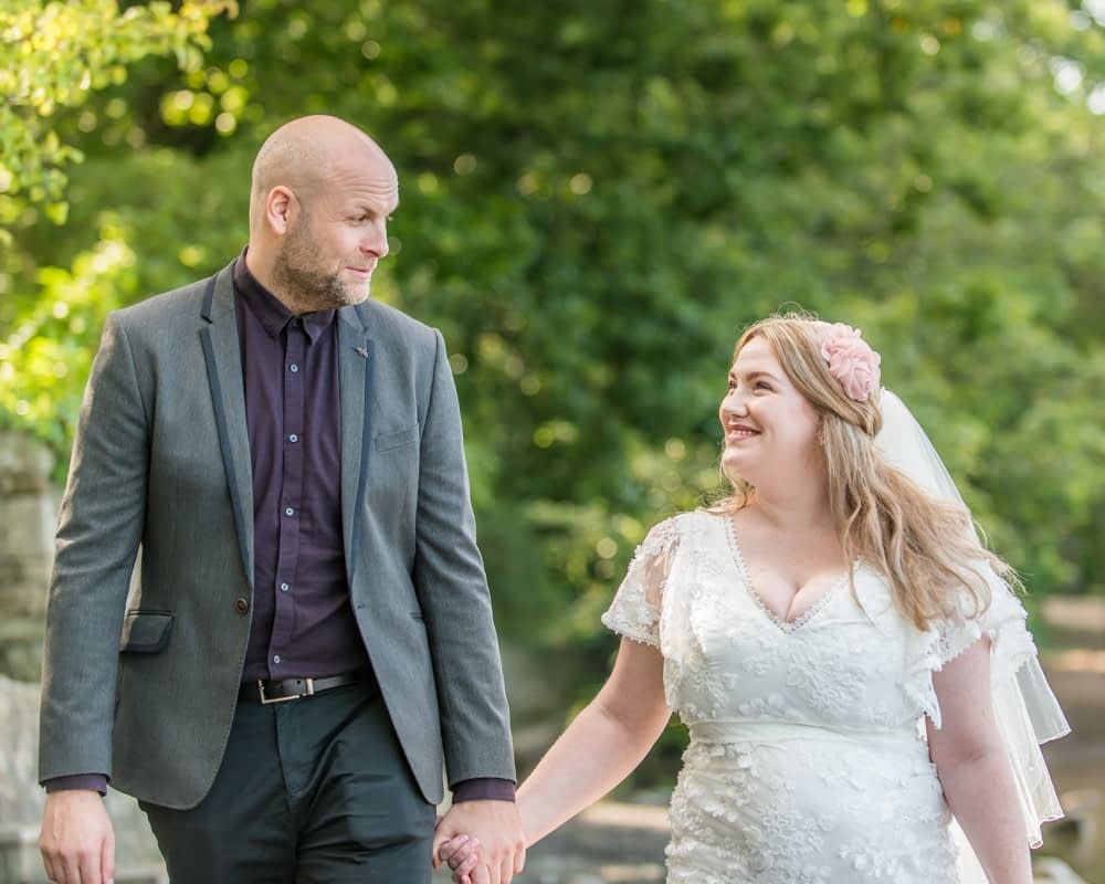 Holding hands with hubby, Derwentwater Rock the Dress, Lake District wedding photographer