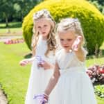 Flower girls scattering confetti at Wortley Hall in Sheffield