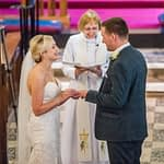 Bride and groom exchanging rings at church, Wortley Hall, Sheffield wedding photography