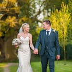 Bride and groom walking in grounds, Wortley Hall, Sheffield wedding photography