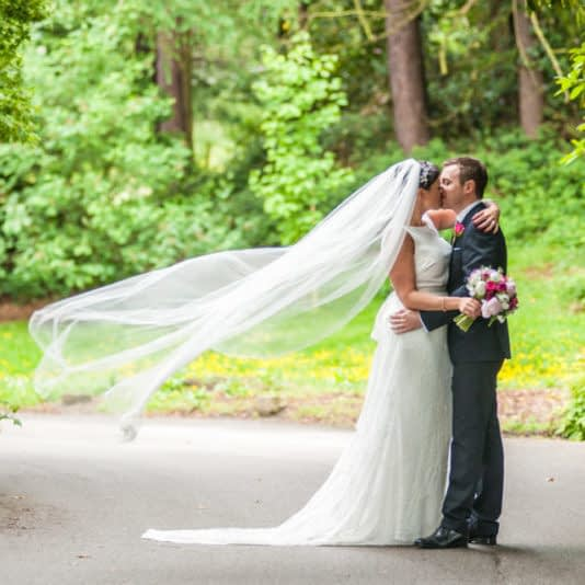 Brides veil blowing in wind, Sheffield wedding photographers, Whirlowbrook Hall