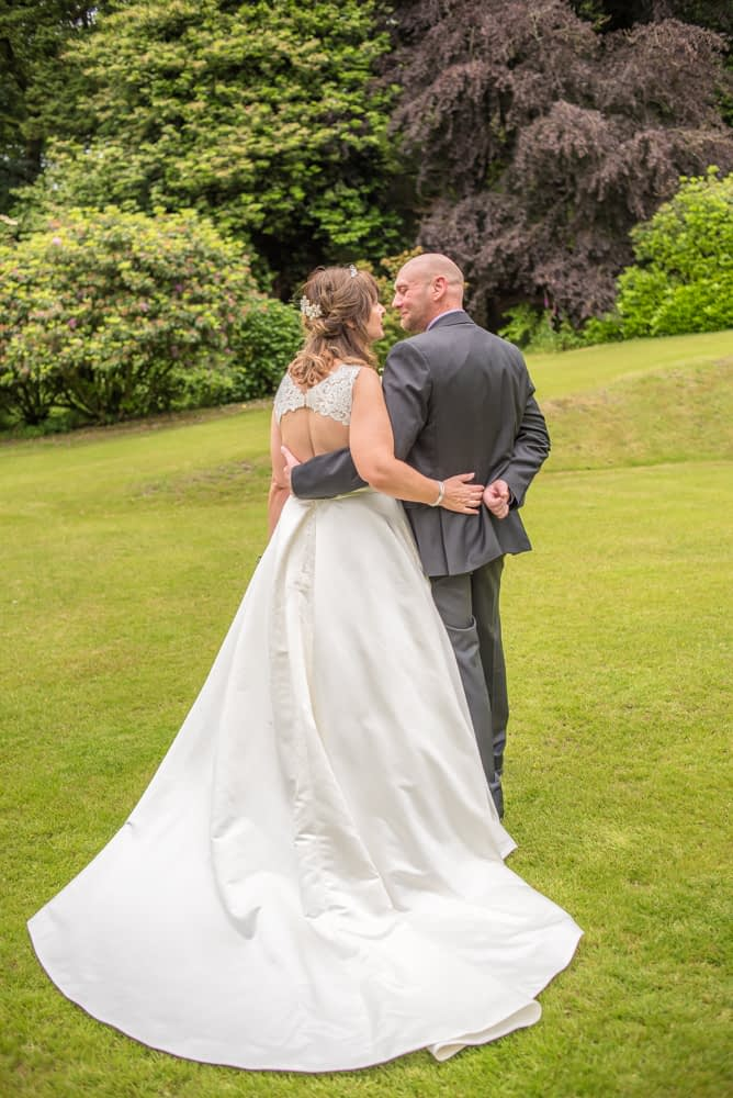 Kissing on the grass in grounds, Merewood Country Hotel Hotel weddings, Lake District