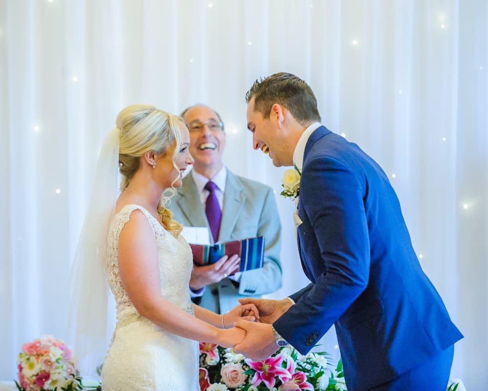 Laughing in ceremony, Maynard wedding photography Sheffield