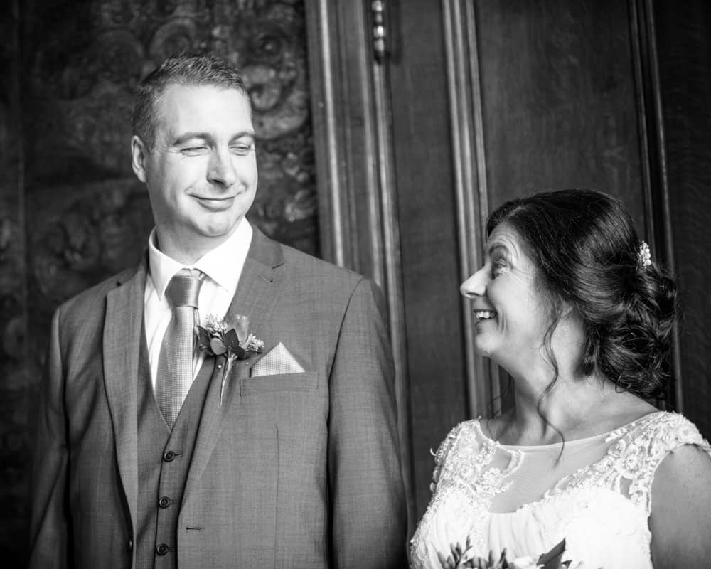 Exchanging looks during ceremony, Lingholm wedding, Lake District