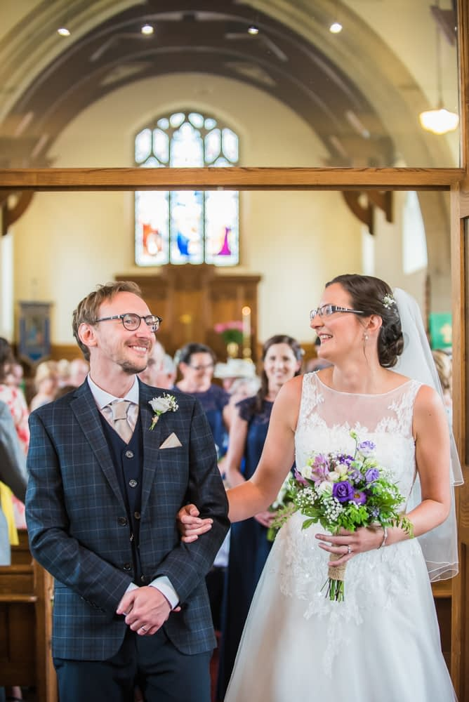 Bride and groom laughing during ceremony, Shireburn Arms, Lancashire wedding photographers