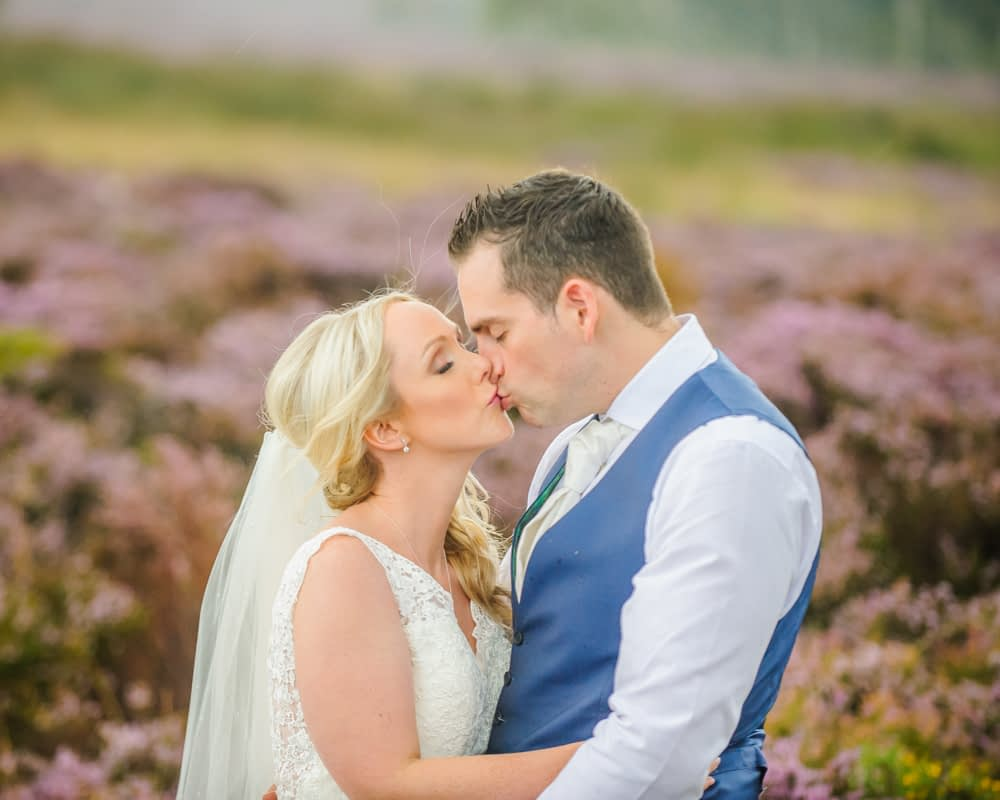 Kisses in Peak District heather, Maynard wedding photography Sheffield