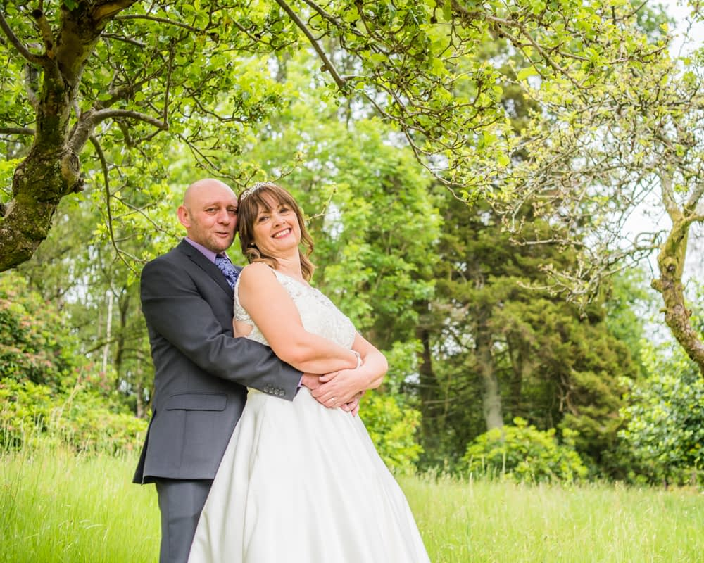 couple cuddling together, Merewood Country Hotel Hotel weddings, Lake District