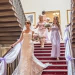 Bridal party coming down the stairs at Wortley Hall
