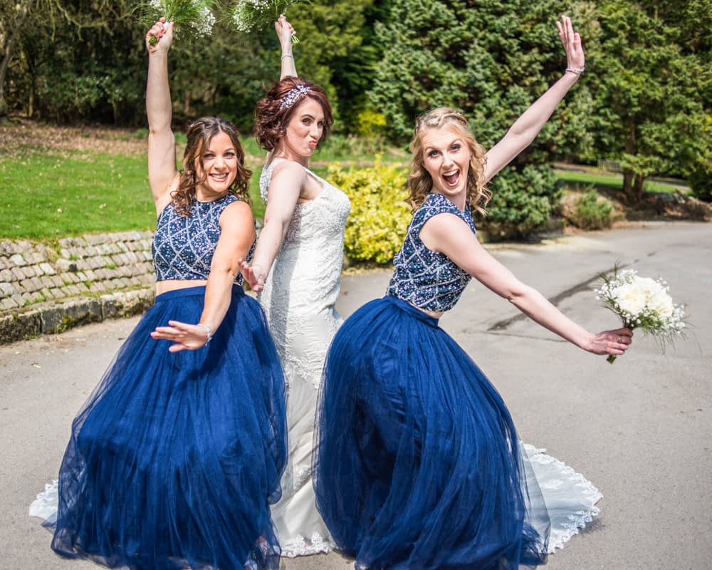 Bridesmaids and bride fun poses at Whirlowbrook Hall in Sheffield