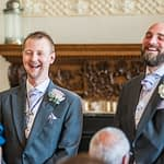 Groomsmen laughing before the ceremony at Wortley Hall
