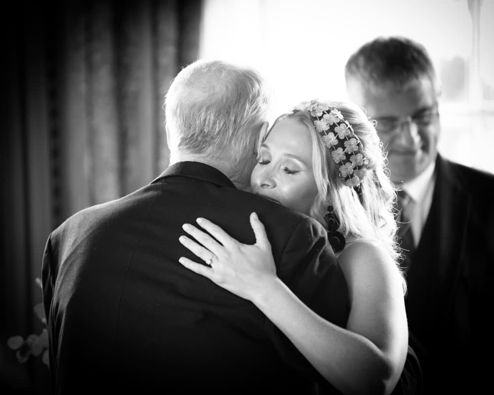 Bride cuddle with Dad, Overwater Hall wedding, Lake District