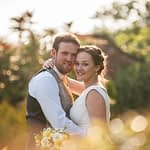 Bride and groom posing in rose garden, Ringwood Hall weddings, Sheffield wedding photographer