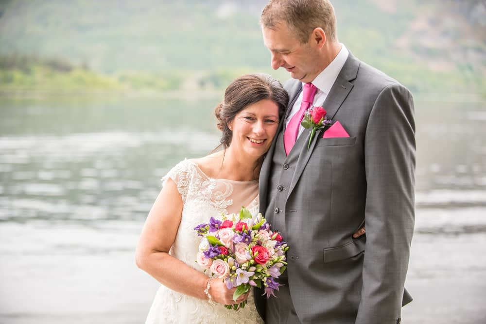 Cuddling up by lake, Lingholm wedding, Lake District