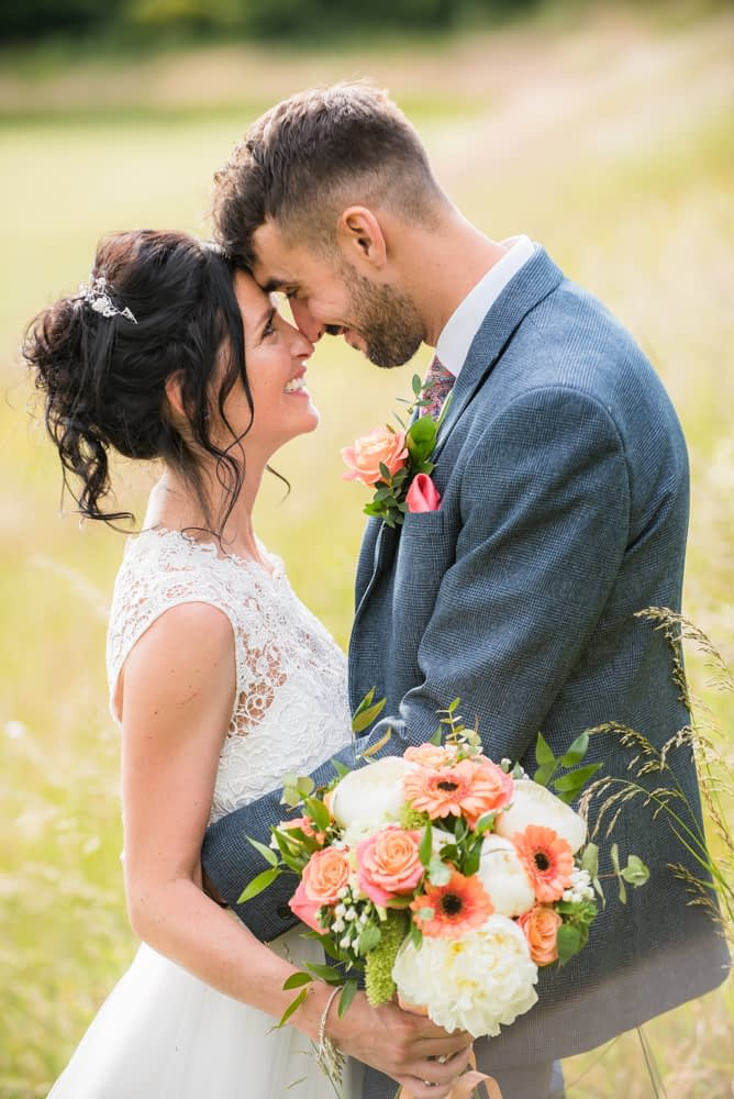 Touching heads together, intimate poses, Lake District weddings