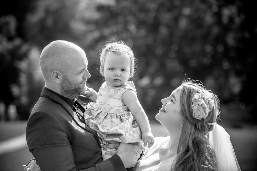 Family poses in black and white, Derwentwater Rock the Dress, Lake District wedding photographer