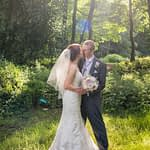 Sunflare cuddle for bride and groom at Wortley Hall in Sheffield