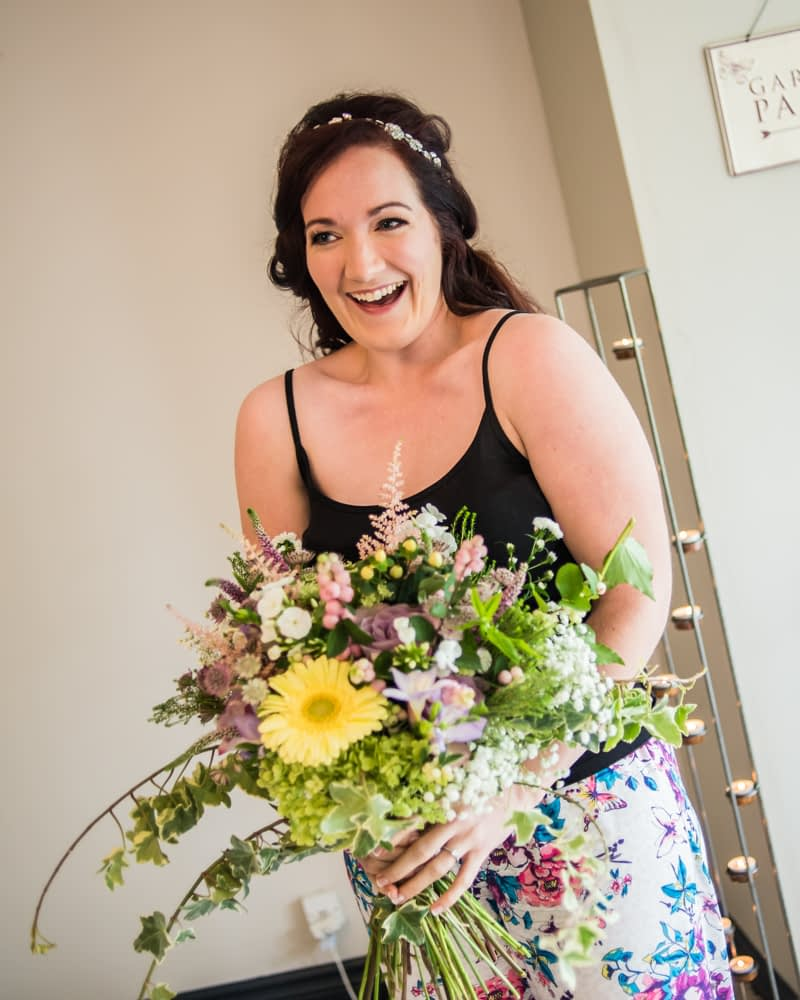 Bride receiving bouquet,  Wentworth Castle Garden wedding, Sheffield photographers