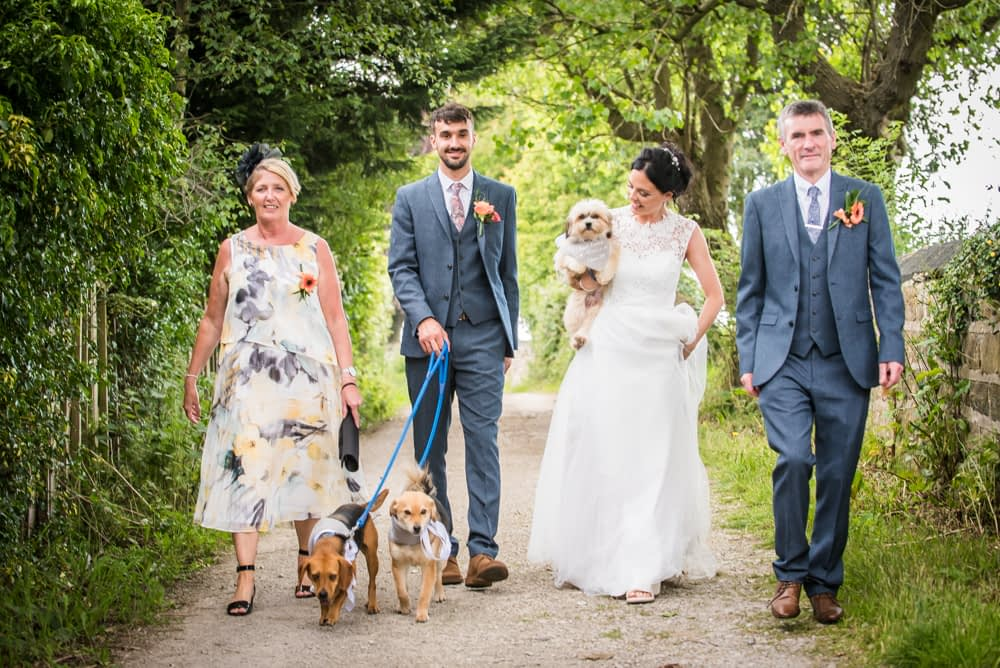 Bride and groom walking with parents,Sheffield wedding photography