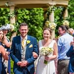 Bride and groom walking back down aisle, outdoor ceremony, Ringwood Hall weddings, Sheffield wedding photographer