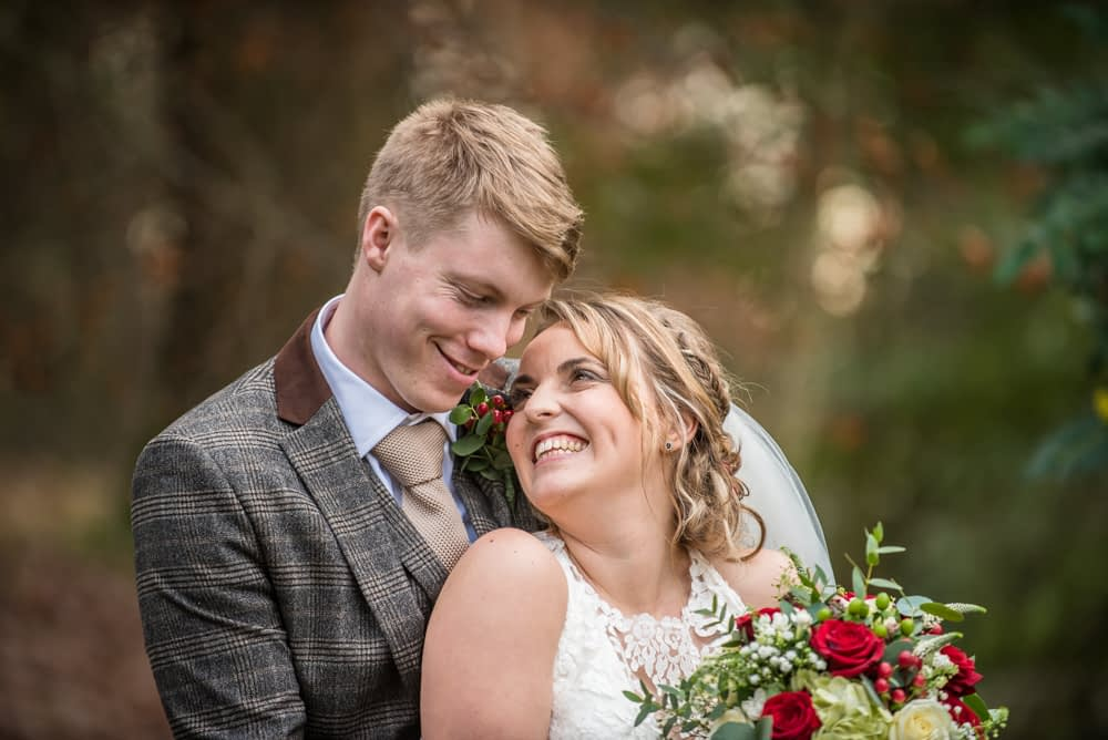 Smiles for bride and groom in gardens, Grange Hotel, Grange over Sands Lake District wedding photographers