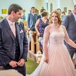 Bride meets groom at top of aisle, Otley Wedding photographers