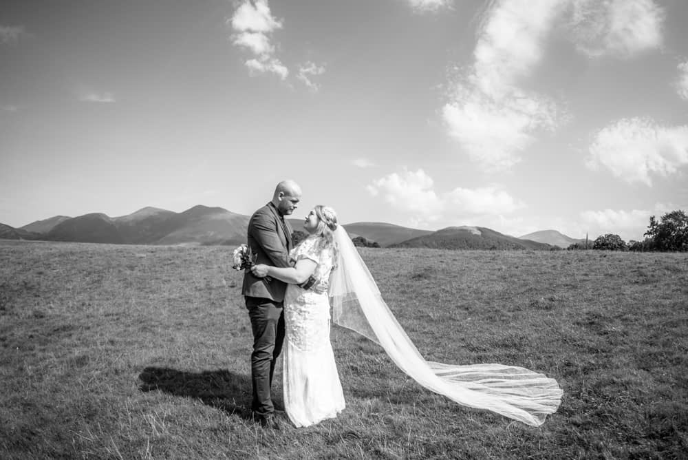Brides veil in breeze, Derwentwater Rock the Dress, Lake District wedding photographer