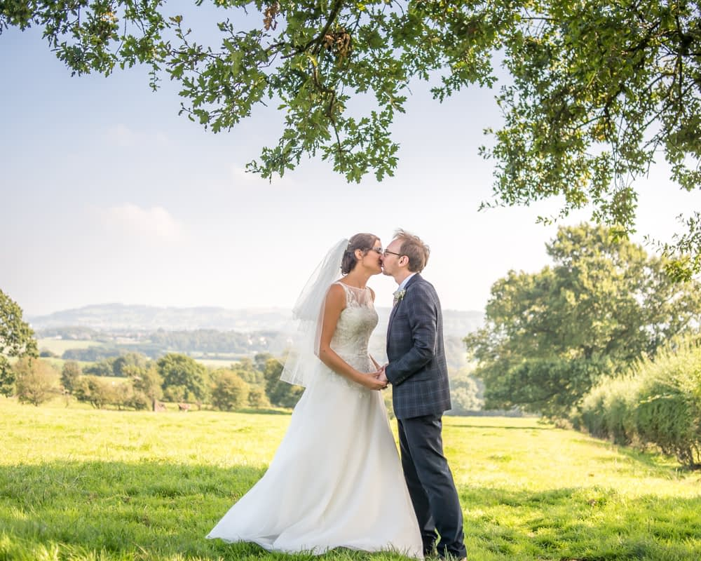 Kissing under tree in the field, Shireburn Arms, Lancashire wedding photographers