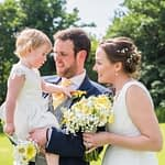 Bride and groom with daughter cuddles, Ringwood Hall weddings, Sheffield wedding photographer