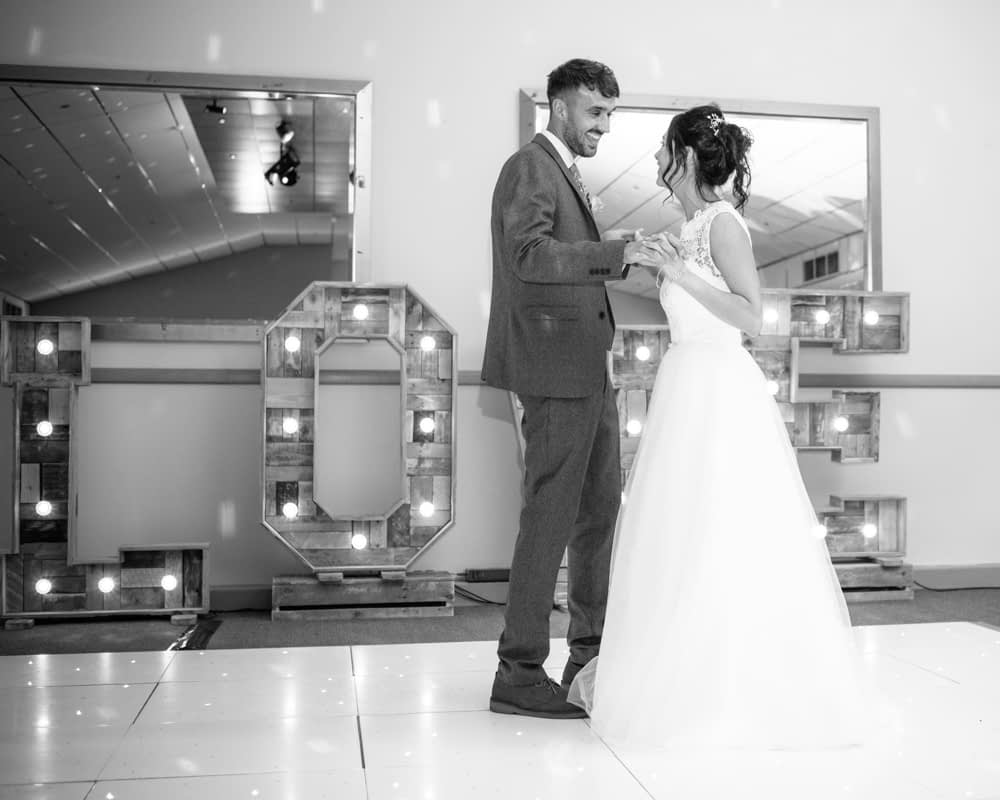 Bride and Groom at first dance with light up Love letters, Sheffield wedding photography