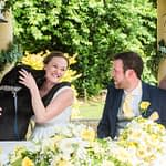 Bride and groom's dog giving bride a kiss during register signing, Ringwood Hall weddings, Sheffield wedding photographer