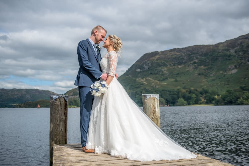 Looking at each other on lake, Inn on the Lake, Ullswater, Lake District documentary wedding photographers