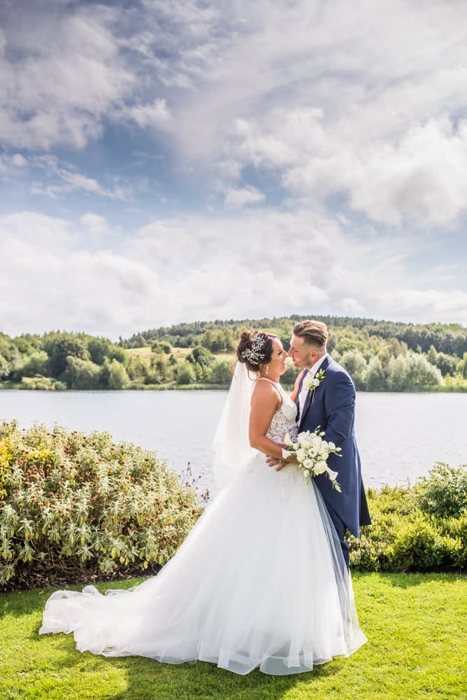 Posing by the lake in the grounds, Waterton Park Hotel weddings, Yorkshire wedding photographers