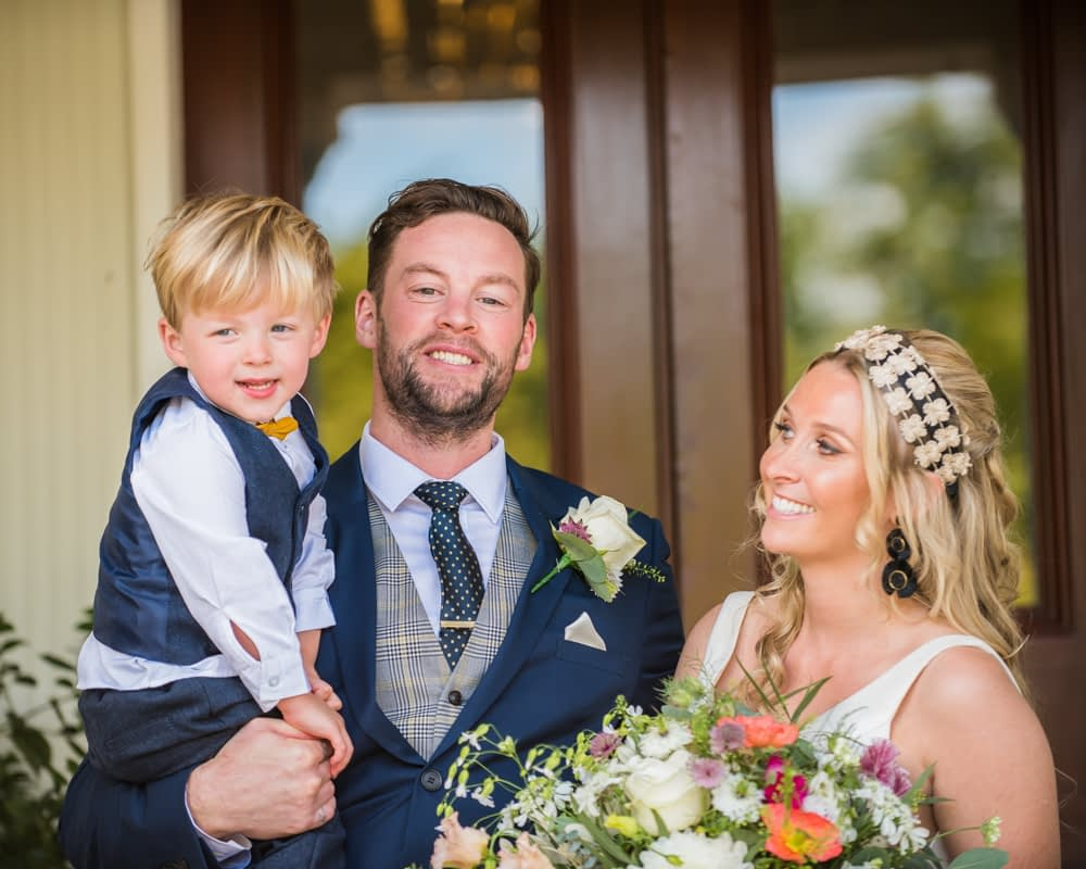 Family photo with Callan, Overwater Hall wedding, Lake District