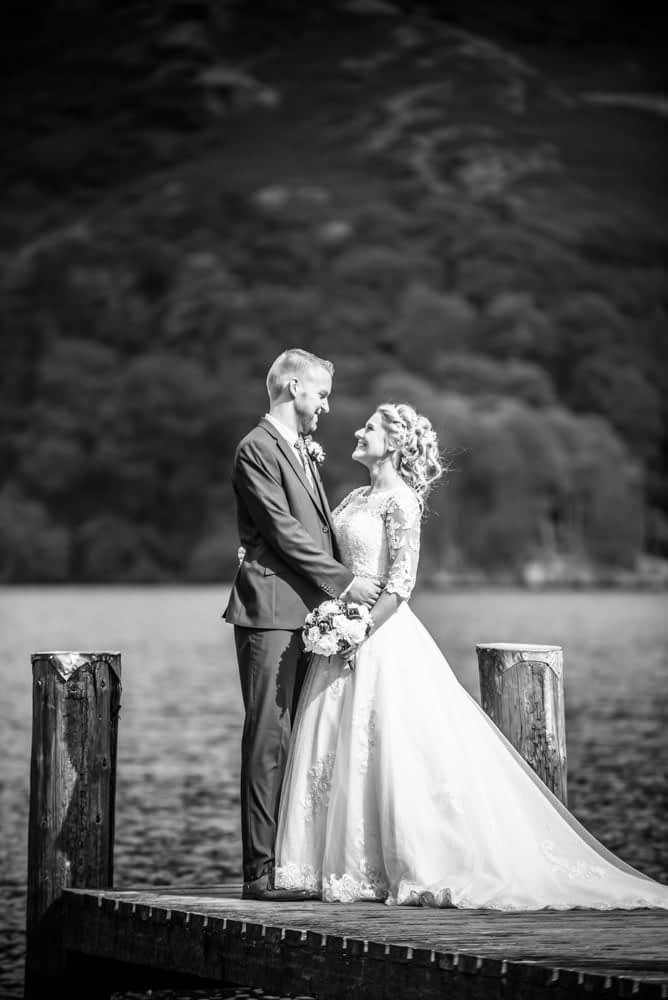 Bride and groom on jetty, Inn on the Lake Weddings, Lake District