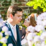 Bride and groom looking at each other through flowers, Ripley Castle weddings, Yorkshire wedding photographers