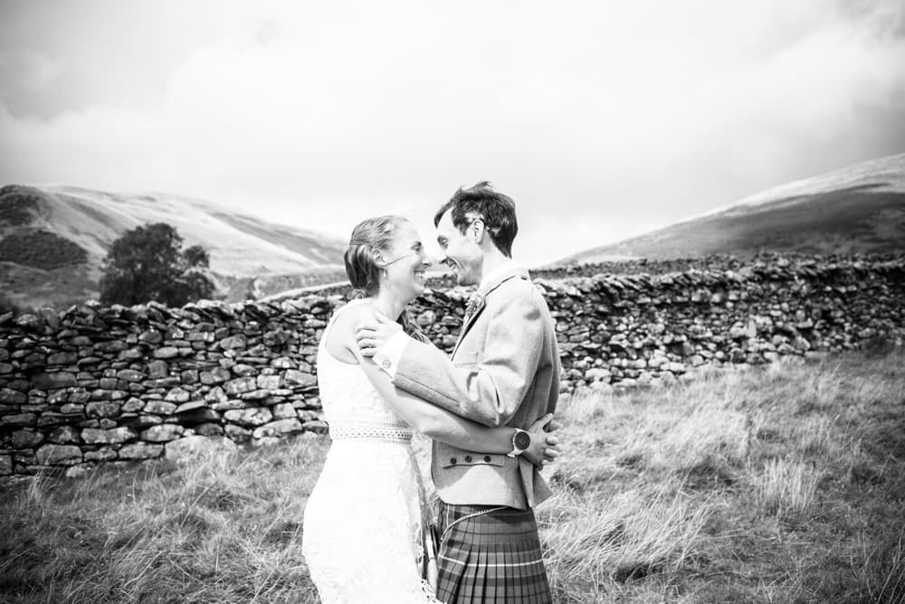 Posing in the Yorkshire Dales, Howgills wedding, Sedbergh, Lake District wedding photographers