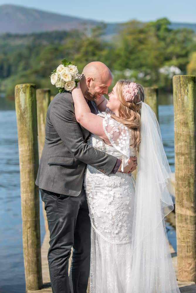 Kisses, Derwentwater Rock the Dress, Lake District wedding photographer