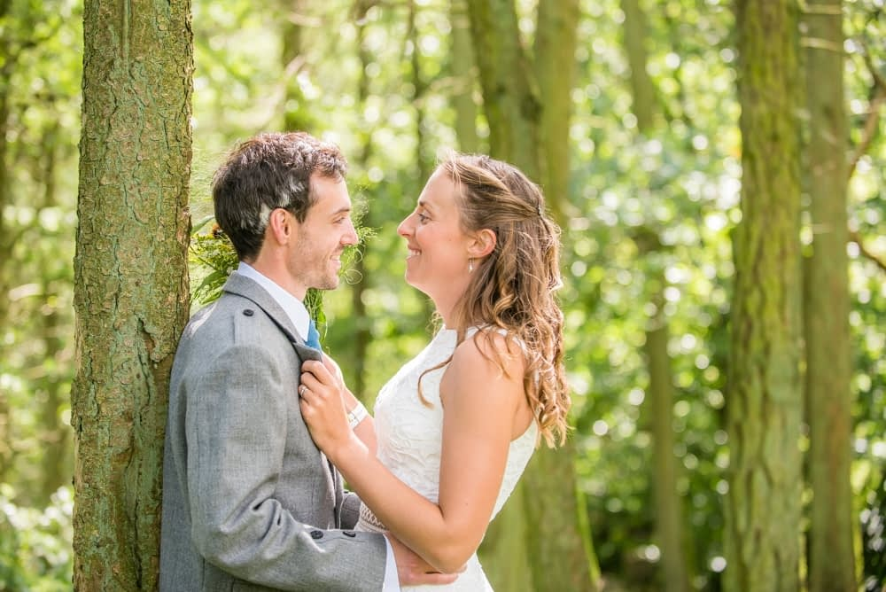 Posing together in the woodland, Howgills wedding, Sedbergh, Lake District wedding photographers