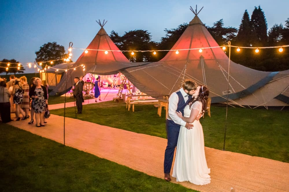 Kisses outside tipi,  Wentworth Castle Garden wedding, Sheffield photographers