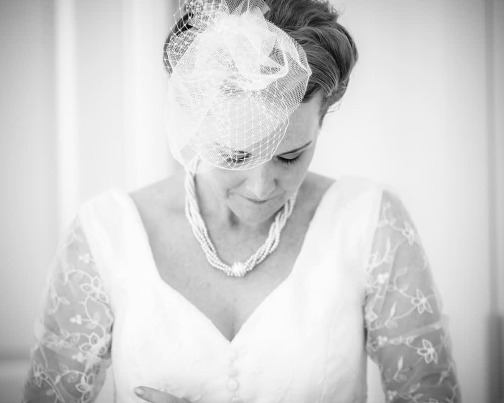 Beth putting on dress, Sheffield wedding photographers
