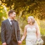Bride and groom walking in sunset light, Wortley Hall, Sheffield wedding photography