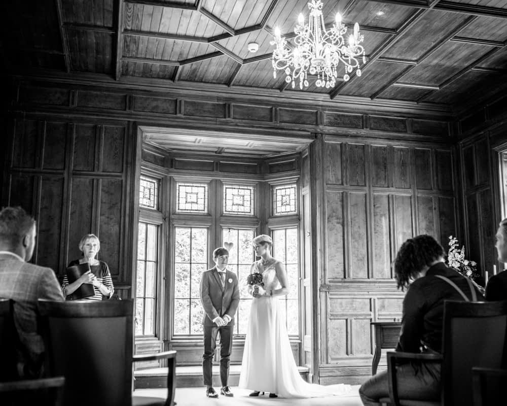 Waiting to go down the aisle, Carlisle Register office, Lake District wedding photography