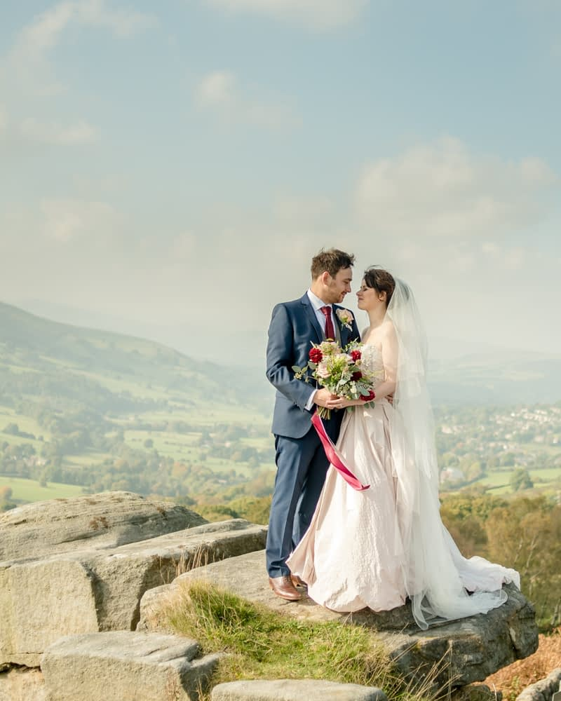 Bride and groom with view of Hathersage, Maynard Arms wedding, Sheffield photographers