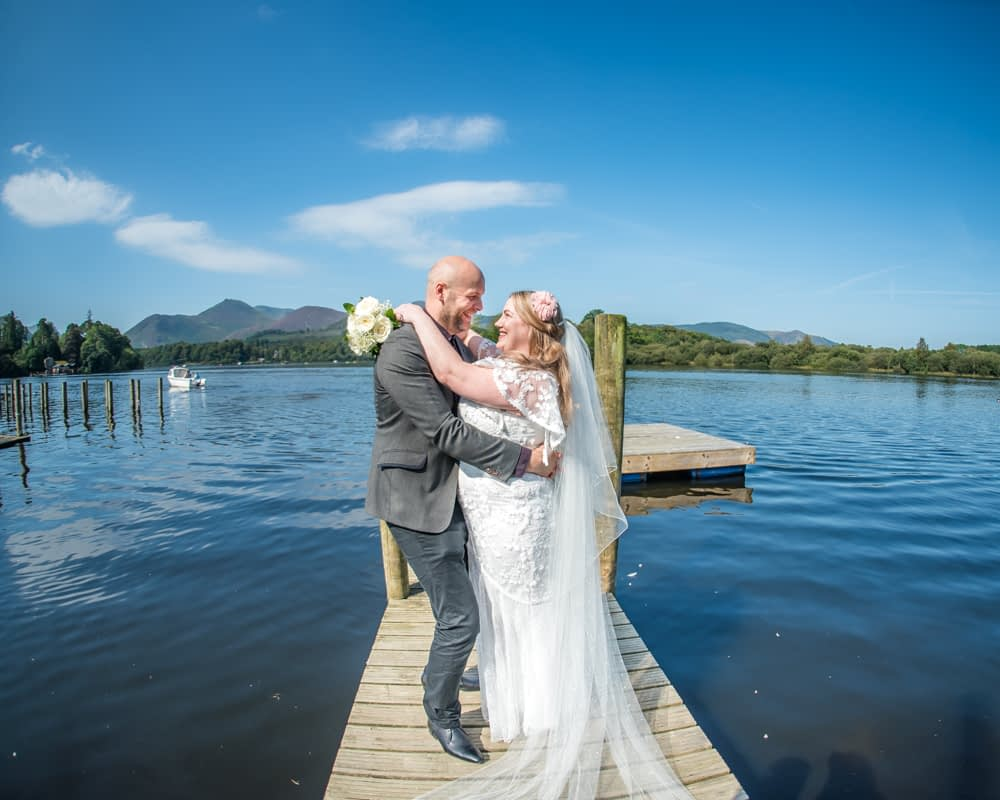 Elopement wedding on jetty, Derwentwater Rock the Dress, Lake District wedding photographer