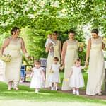 Bride and bridesmaids walking towards the aisle, Ringwood Hall weddings, Sheffield wedding photographer