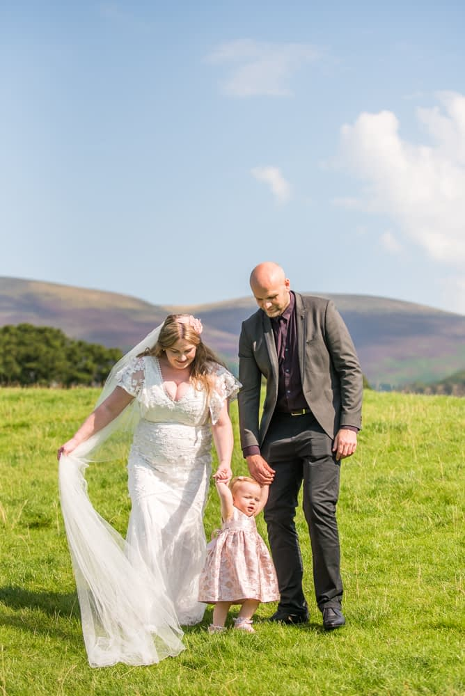 Walking with Mum and Dad, Derwentwater Rock the Dress, Lake District wedding photographer