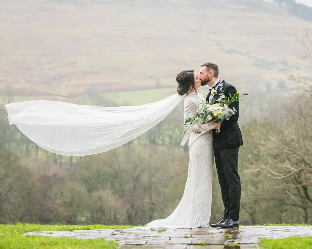Kisses with veil blowing, Losehill House weddings, Sheffield wedding photography