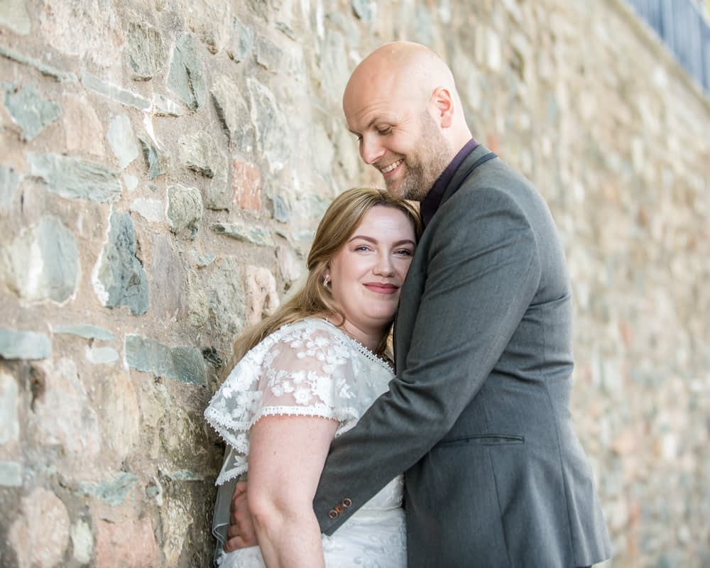 By the wall in Keswick, Derwentwater Rock the Dress, Lake District wedding photographer